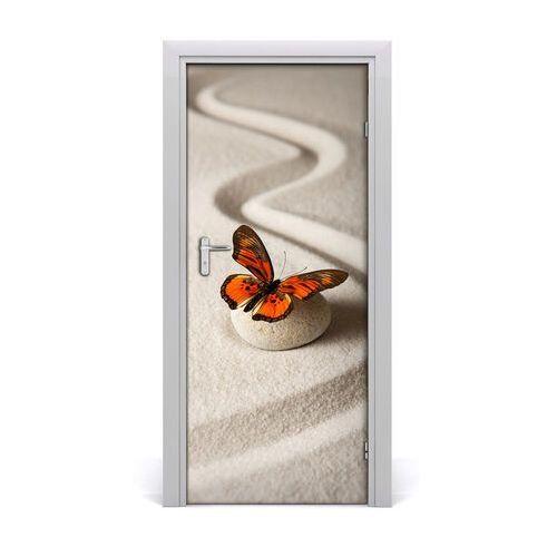 Naklejka samoprzylepna na drzwi kamień zen i motyl marki Tulup.pl