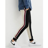 ASOS DESIGN skinny joggers with colour blocking and side stripes - Black, kolor czarny