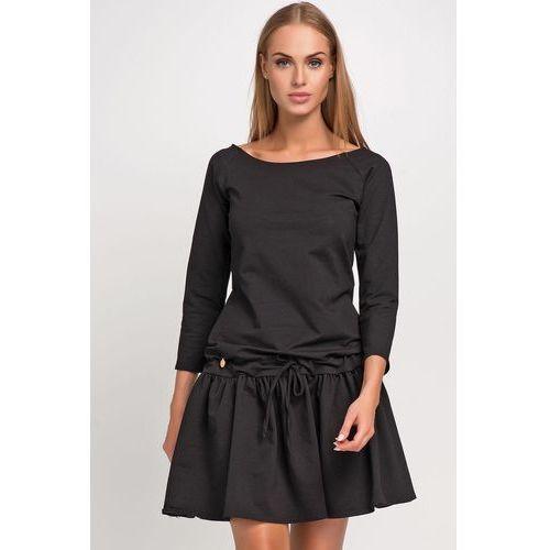 Czarna dresowa sukienka z falbanka i wiązanymi troczkami marki Makadamia