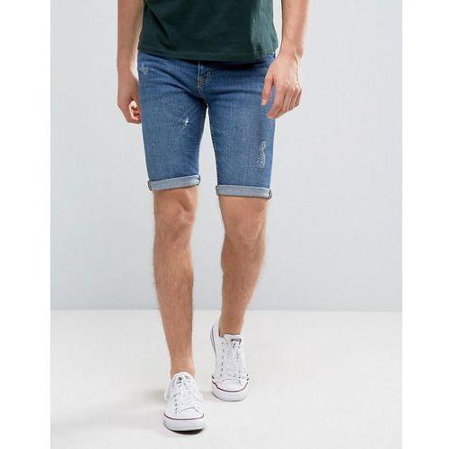 OKAZJA - skinny fit denim shorts with abrasions in mid wash - blue marki New look