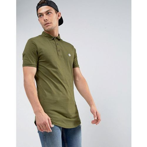 curved hem polo with back panelling - green marki Le breve