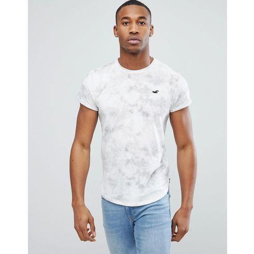 Hollister Crew T-Shirt Slim Fit Scallop Hem Icon Logo in White - White