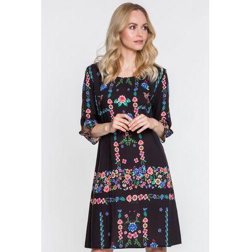 Prosta sukienka w kwiaty z rękawem 3/4 liwia - marki Jelonek