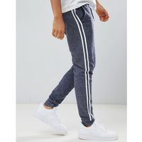 ASOS DESIGN skinny joggers with side stripe taping in grey interest fabric - Navy