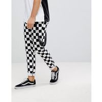 skinny trousers in checkerboard print with strap detail - black marki Asos