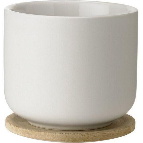 Filiżanka do herbaty theo z podstawką piaskowa marki Stelton