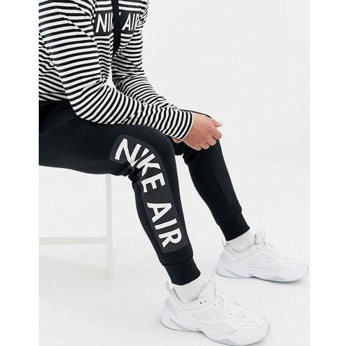 51c3541bd Spodnie męskie · air skinny joggers in black 928637-010 - black marki Nike
