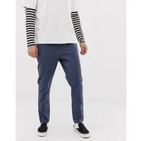 ASOS DESIGN tapered chinos in dark blue with elastic waist - Blue, chinosy