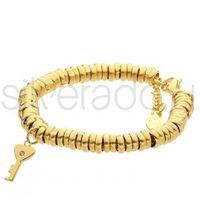 Złota bransoletka z charmsem kluczem z cyrkonią 77-BA373G