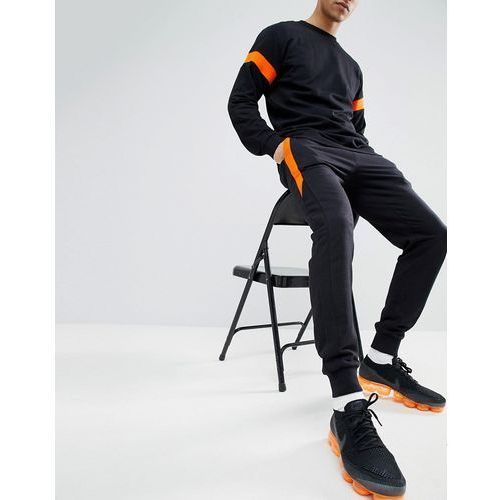 Boohooman skinny fit joggers with stripe detail in black - black
