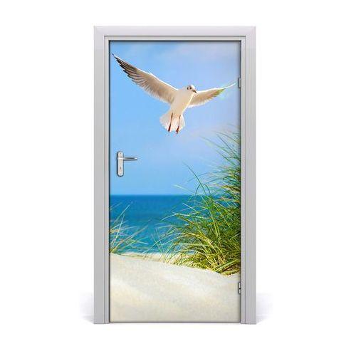 Naklejka na drzwi samoprzylepna Mewa nad wydmami
