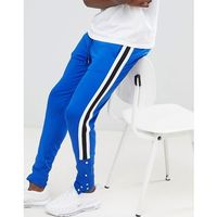 ASOS DESIGN skinny retro track joggers in blue with side stripe and popper hem - Blue, kolor niebieski