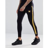 Good for nothing skinny joggers in black with gold stripe - black