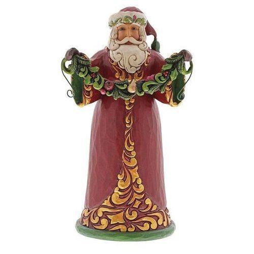 Mikołaj trzymający świąteczną girlandą evergreen cheer (red and green santa holding garland) 6001053 figurka ozdoba świąteczna marki Jim shore