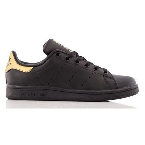 originals tenisówki i trampki core black/gold metallic marki Adidas