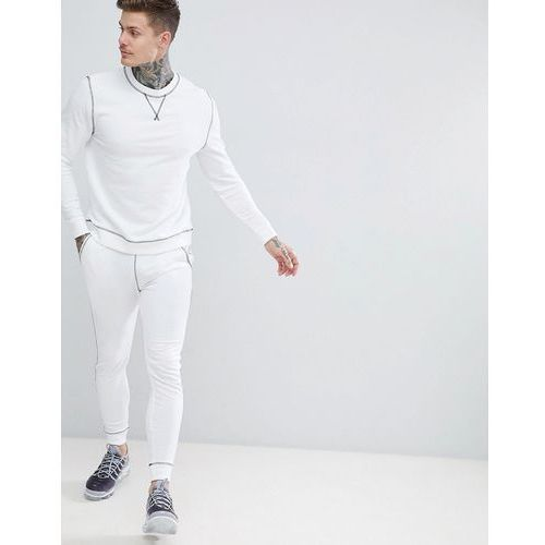 Asos design tracksuit sweatshirt/super skinny joggers in white with contrast stitching - white