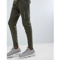 ASOS DESIGN Skinny Joggers With MA1 Pocket In Khaki - Green, kolor zielony