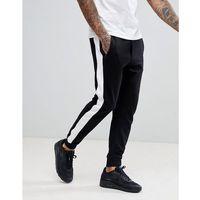 Bershka Side Stripe Joggers With Zip Pockets In Black - Black, w 3 rozmiarach