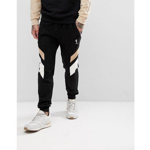 Religion tapered fit jogger in suedette with contrast panels - black