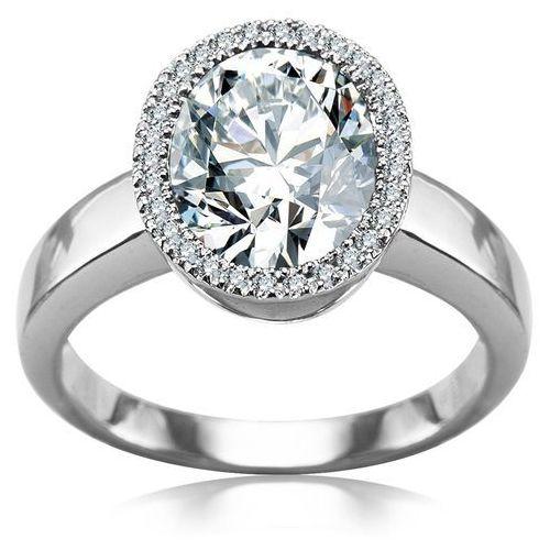 Pierścionek z diamentami i białym topazem