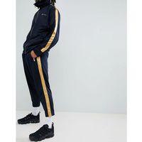 skinny jogger in navy with gold side stripe - navy marki Mennace