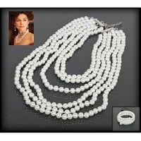 Wykwintny komplet biżuterii z białych pereł: naszyjnik i bransoletka