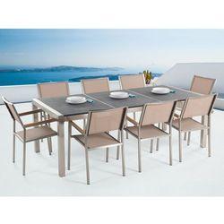 Meble ogrodowe - stół granitowy 220 cm czarny palony z 8 beżowymi krzesłami - grosseto wyprodukowany przez Beliani