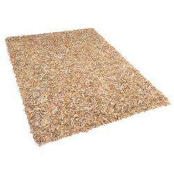 Dywan beżowy - 80x150 cm - Shaggy -skórzany - MUT (7081456394694)