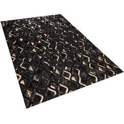 Dywan czarno-złoty 140 x 200 cm skórzany develi marki Beliani