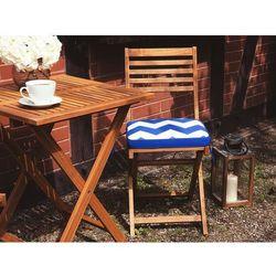 Beliani Stół z krzesłami do ogrodu z niebiesko-białymi poduszkami w zygzaki fiji
