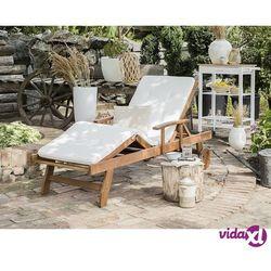 drewniana leżanka ogrodowa z poduszką jasne drewno i złamana biel java marki Beliani