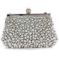 Zmysłowa srebrna torebka wizytowa z koralików - srebrny