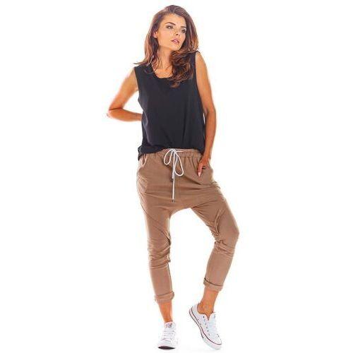 Dresowe spodnie z obniżonym krokiem - beżowe, bawełna