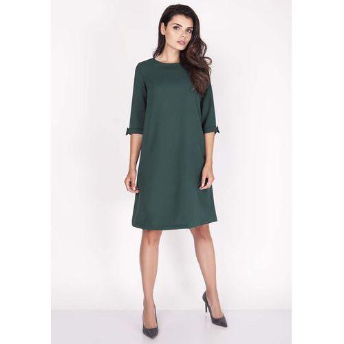 7d250725f2 Zielona sukienka trapezowa mini z uroczymi kokardkami