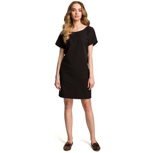 0b3a96bc3c Czarna miejska sukienka z wycięciem i kokardą na plecach