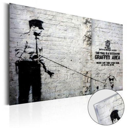 Obraz na szkle akrylowym - graffiti area (police and a dog) by banksy [glass] Artgeist